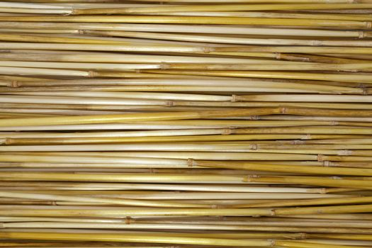 a long dry straw arranged in stripes
