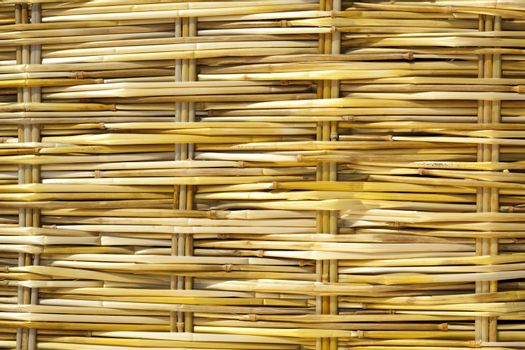 yellow plaited straw on mat as background