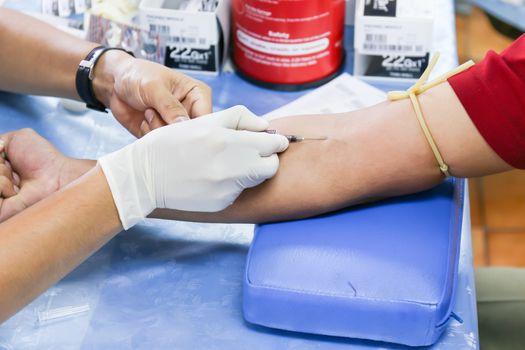 Donating blood at hemotransfusion station