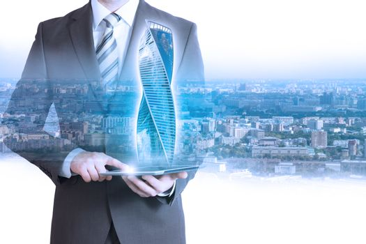 Businessperson with tablet and 3d building model