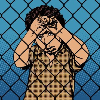 Child boy refugee migrants behind bars the prison boundary
