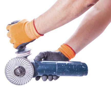 Men's hands hold a circular saw