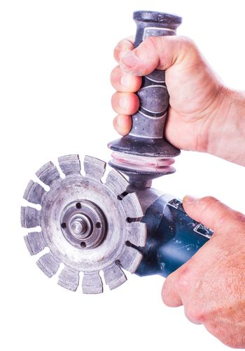 circular saw in male hands