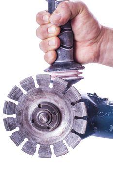 circular saw in male hand
