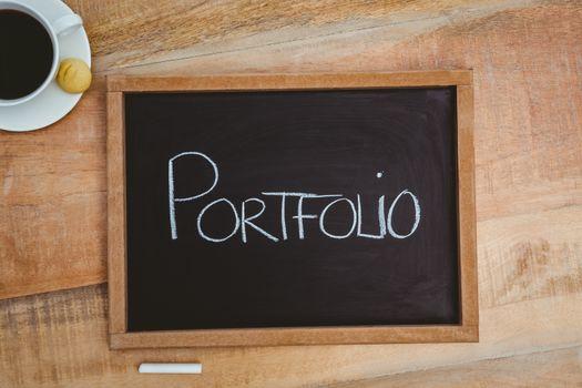 Portfolio against a big blackboard
