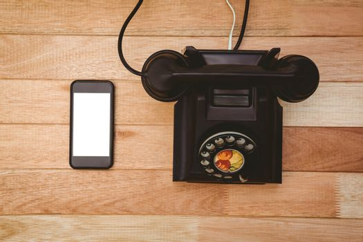View of an old phone and a smartphone