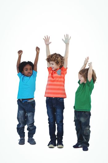 A row of children standing together with raised arms