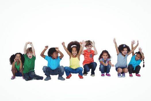 A row of children crouching down together