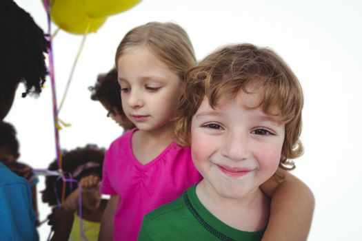 Group of kids together with balloons