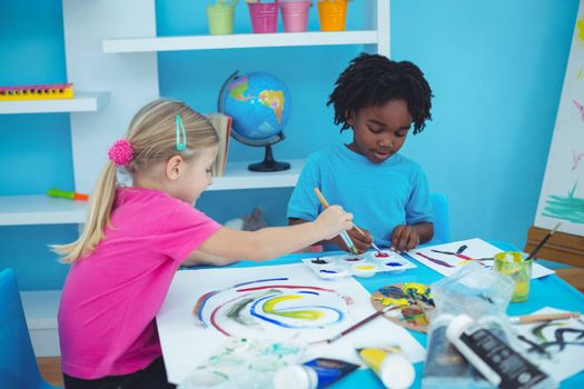 Happy kids enjoying arts and crafts painting