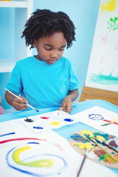 Happy kid enjoying arts and crafts painting