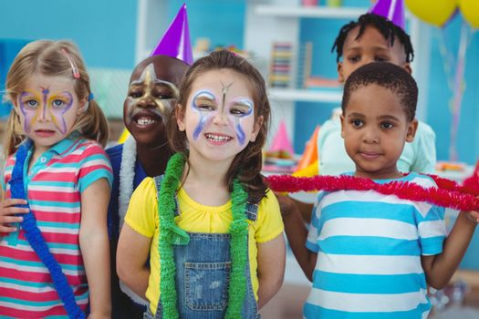 Happy kids enjoying a birthday party together