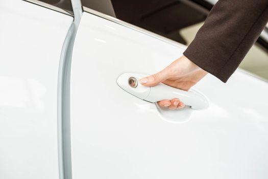 Saleswoman holding a car handles