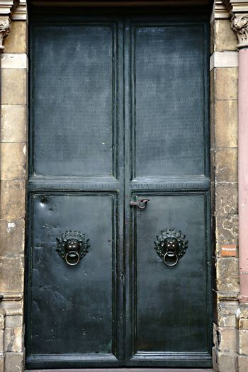 Mainz, Germany - September 04, 2015: The heavy iron door of the entrance to the Mainz Cathedral engraved with Latin words on September 04, 2015 in Mainz.