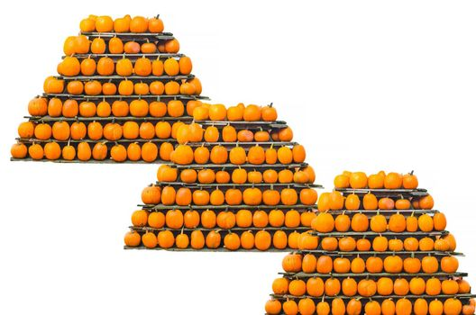 Three decorative pumpkins stacked in a pyramid shape.