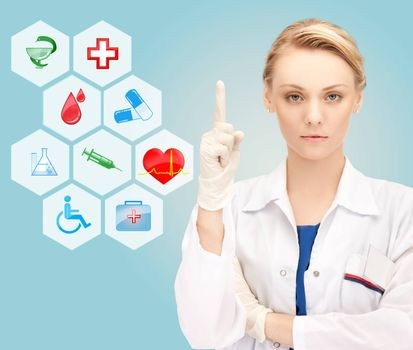 smiling young female doctor pointing her finger up