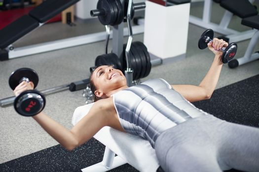 Young woman doing chest exercise