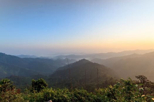 Beautiful sunrise in the hills rain forests, Thailand.