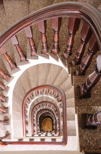 Vintage spiral staircase Interior in old house.