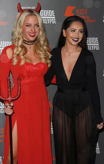 ENGLAND, London: Chloe Paige and Havva Rebke attend the Kiss FM Haunted House Party in London on October 29, 2015. Costumes ranging from the Rock band KISS to the devil were on display as various stars walked the red carpet at the party which featured musical performances by Rita Ora, Jason Derulo and band Little Mix.