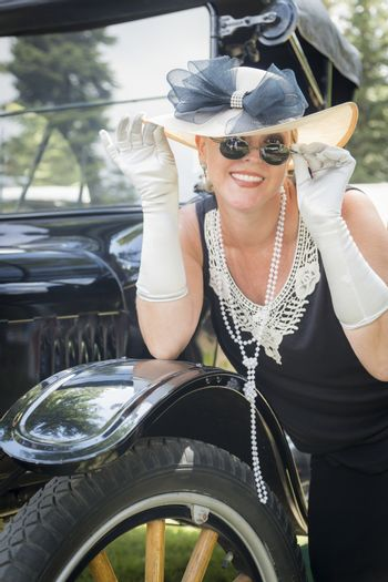 Woman in Twenties Outfit Near Antique Automobile