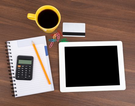 Blank copybook with tablet and calculator