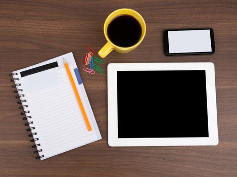 Blank copybook with tablet and coffee
