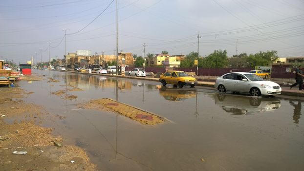 IRAQ, Baghdad : A street of Baghdad, Iraq, under the water after heavy rains on October 29, 2015, resulting a major flooding. According to a spokesman for the meteorological department, more than 2 inches of rain fell on the city in 24 hours. Some motorists were forced to leave their cars when they became stuck in deep water.