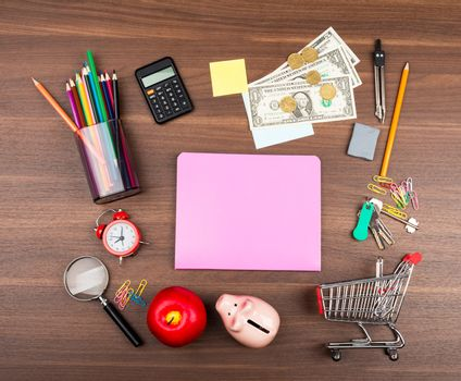 Shopping cart with pink copybook