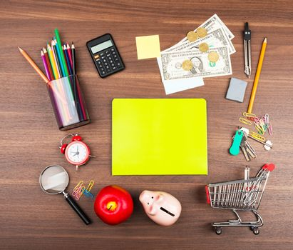 Shopping cart with green copybook