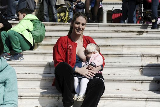 GREECE, Athens: A mother breastfeeds her baby during the 6th Panhellenic synchronized public breastfeeding festival, in Athens on November 1, 2015. The event takes place simultaneously in 50 cities of Greece.