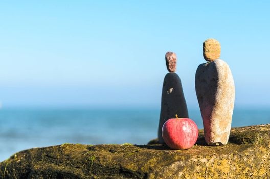 Figurines of man and woman of the stones at the sea