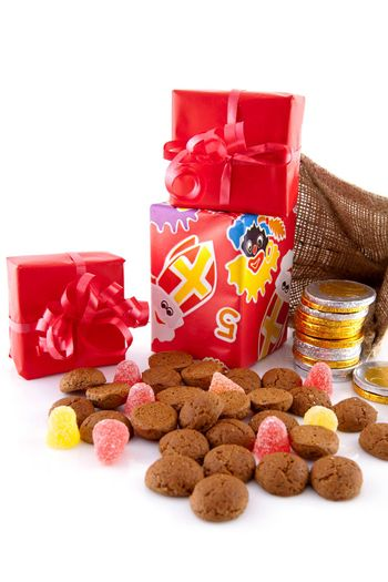 Typical Dutch celebration: Sinterklaas with surprises in bag and ginger nuts, ready for the kids in december. Isolated on white background