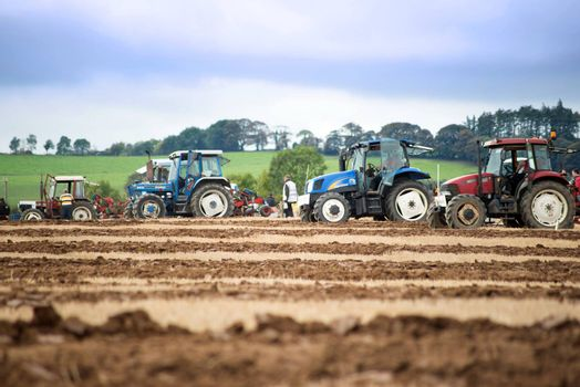 tractors competing in the irish national ploughing championships in ireland