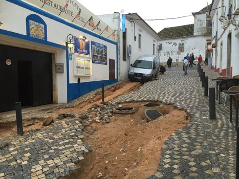 PORTUGAL, Albufeira : A road has been devastated by flash floods, on November 2, 2015. A man aged 79 died during the flooding.