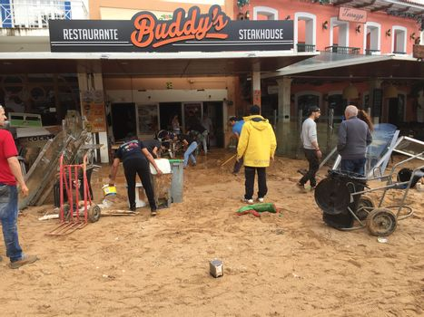 PORTUGAL, Albufeira : Council workers are cleaning up the main square of Albufeira, southern Portugal, after the flash floods, on November 2, 2015. A man aged 79 died during the flooding.
