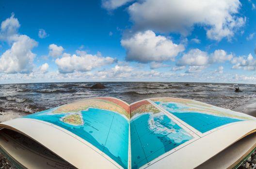 Atlas book at seashore