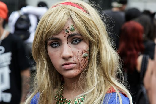 Sao Paulo, Brazil November 11 2015: An unidentified girl in Super Woman costumes in the annual event Zombie Walk in Sao Paulo Brazil.