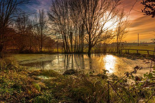 Winter sunset on pond