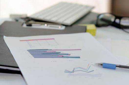 Business of financial analytics desktop with accounting charts and diagrams