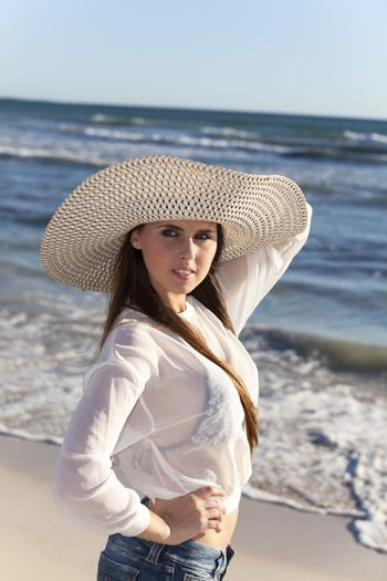 woman with a hat on a beach