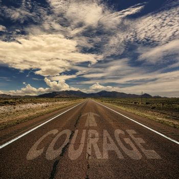 Conceptual Image of Road With the Word Courage