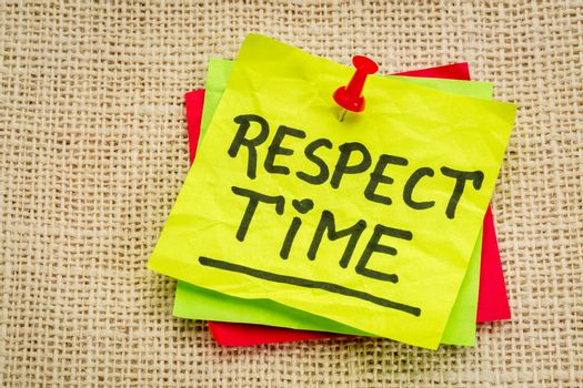 respect time reminder - handwriting on a sticky note against burlap canvas