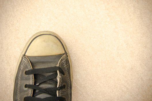 Vintage sneakers on the floor.