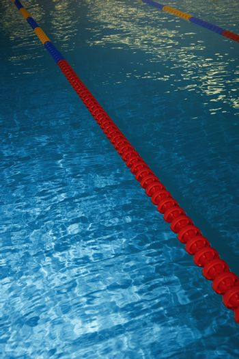 Swimming pool with lane markers. Vertical photo