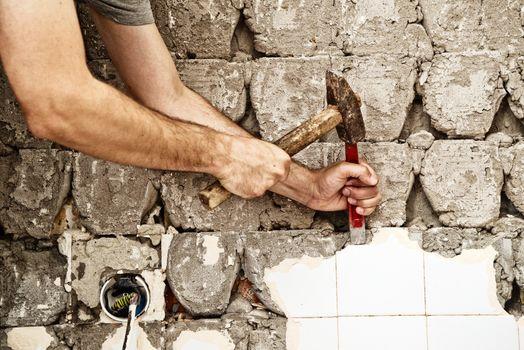Breaking ceramic tiles