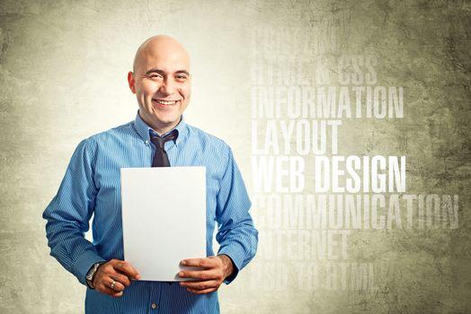 Web designer holding paper