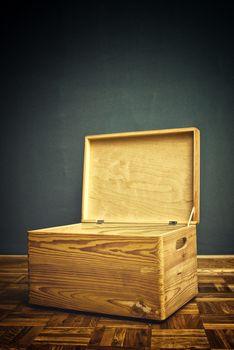 Open Wooden crate box on the floor