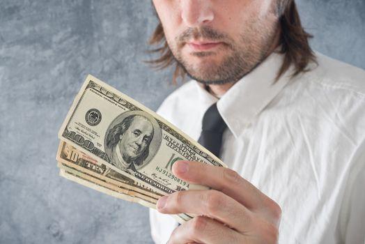 Businessman holding United states dollars