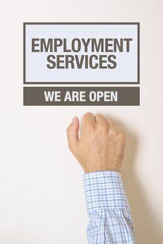Businessman knocking on employment services door